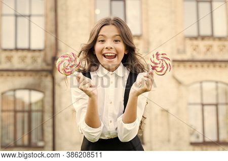 Sugar Addiction. Cheat Meal Day. Happy Kid With Sweet Candy. Kid Child Holding Lollipops Candy Outdo