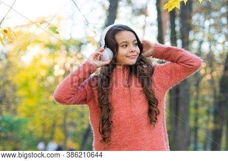 Kid Listen Music In Autumn Park. Fall Is A Time For Study. Back To School. Concept Of Online Educati