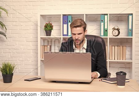 Businessman Drinking Coffee. Confident Man Use Laptop. Handsome Man In Business Office. Inspired Wit