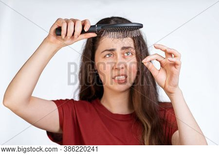 Portrait In A Blur, A Distressed Brunette Woman Holds A Comb Over Her, Clearing It From A Pile Of Fa