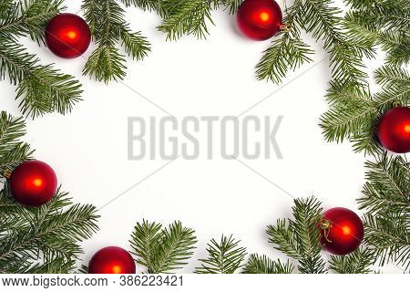 Green Christmas Fir Tree Branches With Red Balls And Copy Space. Christmas Green Framework Isolated