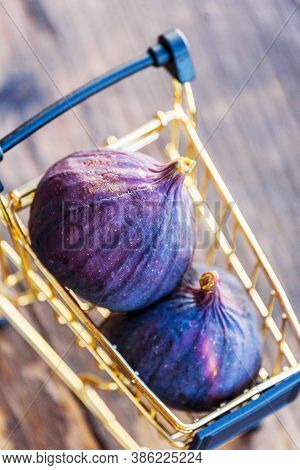 Fresh Figs . Beautiful Blue Violet Figs. Figs In Grocery Cart On Wood Background