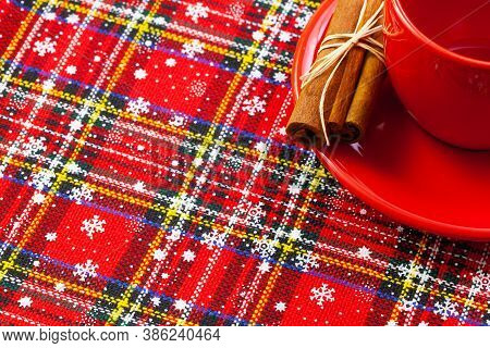 Photo Of Red Cup Of Coffee, Cinnamon And Placemats. Winter Holidays. Merry Christmas And Happy New Y