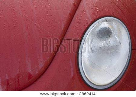 Red Car After Rain