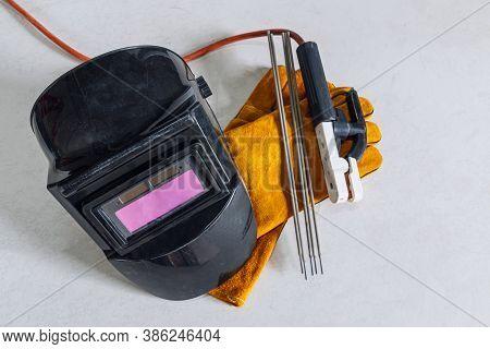 Welding Equipment Including Leather Welding Gloves, Welding Mask, Hand Held Welding Electrode On  Fl