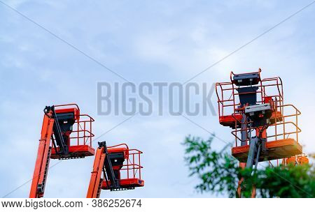 Articulated Boom Lift. Aerial Platform Lift. Telescopic Boom Lift Against The Sky. Mobile Constructi