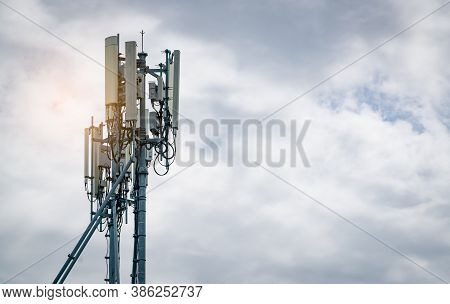 Telecommunication Tower With White Cloudy Sky. Antenna. Radio And Satellite Pole. Communication Tech