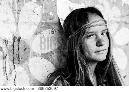Portrait of young girl hippie. Black and white photo.