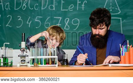 Teacher And Boy In Chemical Laboratory. Study Chemistry And Biology. Studying Is Interesting. Study