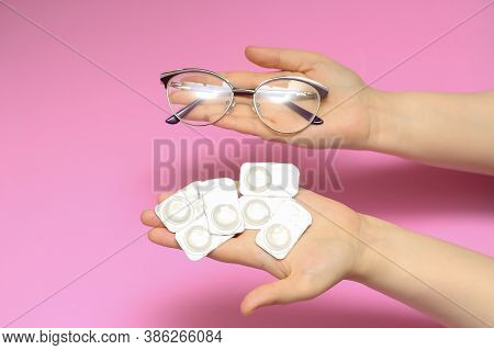 Glasses And Contact Lenses On A Pink Background. Vision Correction. Glasses For Sight. Glasses Or Co