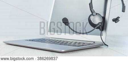 Laptop. Mockup Screen And Headphones On Grey Desk And Plain Background Banner. Distant Learning Or W