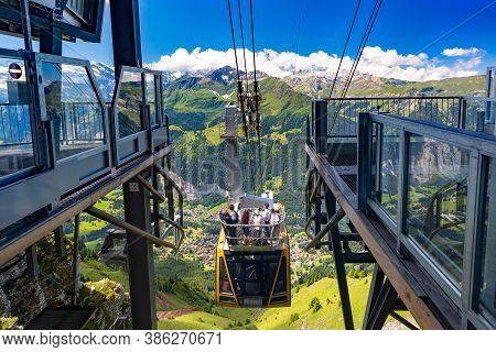 Cable Car From Mountain Village Wengen To Viewpoint On Cliff In Mannlichen, Switzerland, Bernese Obe