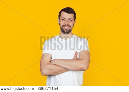 Young Man With Beard In White T-shirt Happy Face Smiling With Crossed Arms Looking At The Camera. Po