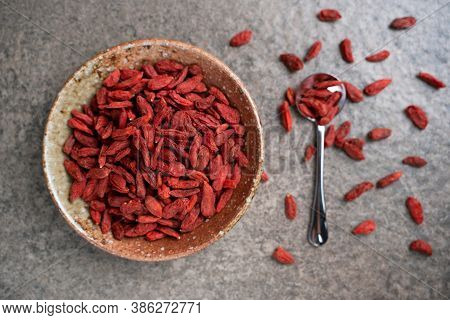Goji Berries In A Bowl On Table. Top View Goji Berries With Copy Space.