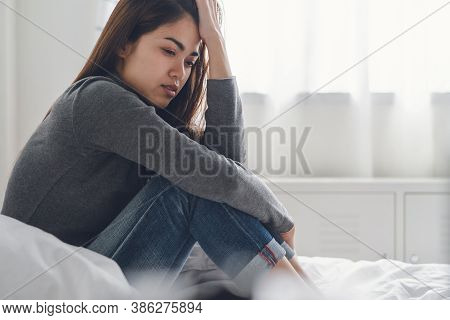 Suffer From Depression , Mental Health Problem. Asian Young Woman Sitting On The Bed Feeling Depress