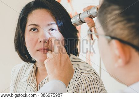 Doctor Examining Eyes Of Patient In The Clinic.