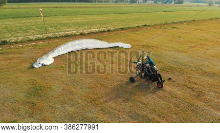 Paramotor Gliding Tandem Preparing To Take Off. High Quality Photo