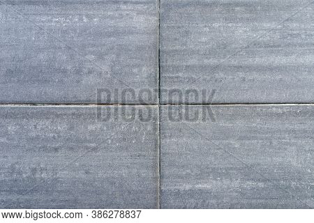 Quadratic Old Gray Concrete Wall With Cracks And Putty Stains.gray Background