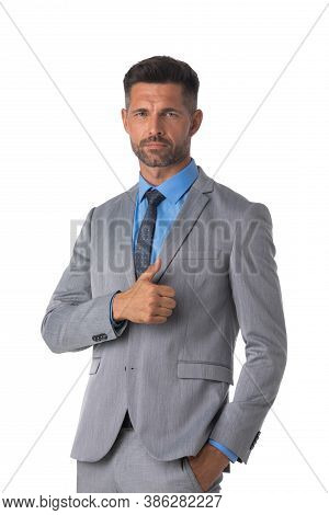 Portrait Of Serious Mid Adult Business Man With Thumb Up Gesture Isolated On White Background