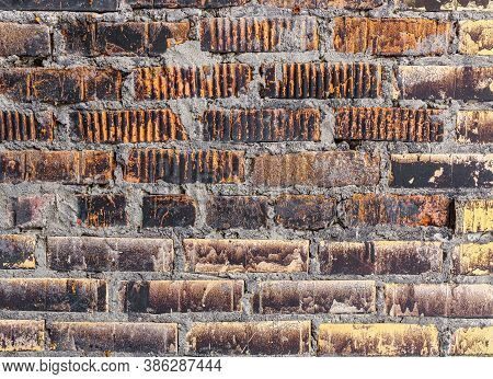 Old Brick Wall Covered With Soot And Dirt. Stone Background, Texture