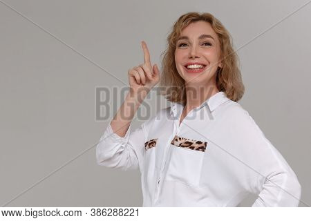 Beautiful Woman Having A Bright Idea Pointing Her Finger Up