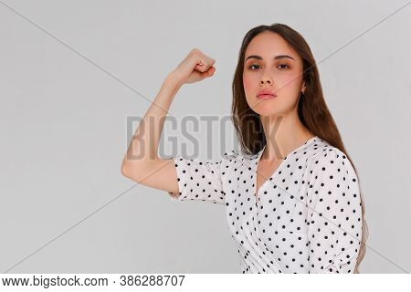 Woman Demonstrate And Shows Brawn With Motivated Inspired Face, Fitness Center Advertisement