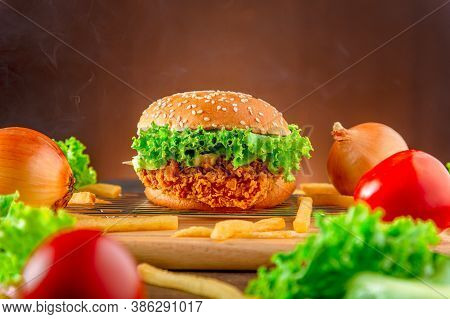 Hemberger Fried Chicken. Delicious Hamburgers, Delicious Fast Food Or Junk Food.  A Large Hamburger