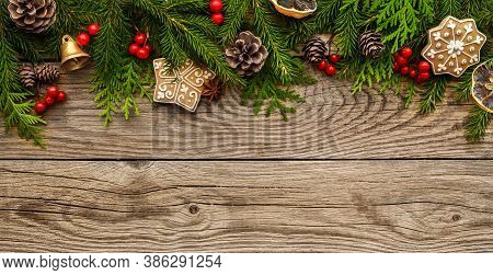 Fir Tree Branches With Christmas Decorations On Wooden Background. Christmas Banner, Border. Top Vie