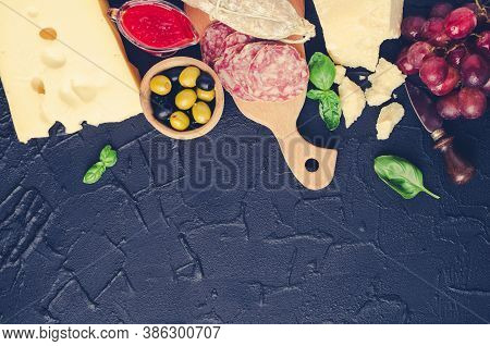Table Full Of Mediterranean Appetizers, Tapas Or Antipasti. Assorted Italian Style Banquet Food Set.
