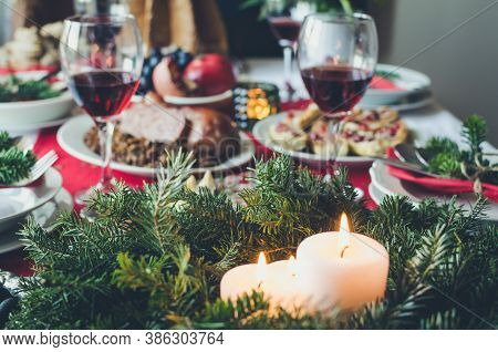 Family Together Christmas Celebration Concept. Festive Place Setting For Holiday Dinner With Natural