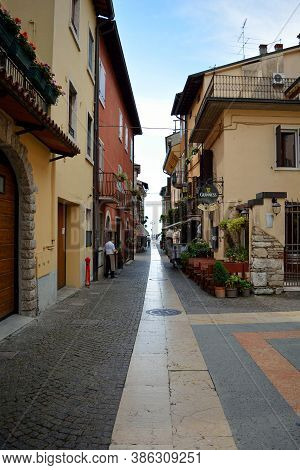 Lazise, Italy 06 13 2016: Traditional Street Near Lake Garda With Restaurants And Shops