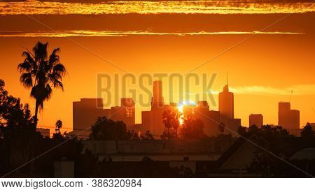 Downtown Los Angeles Sunrise over city buildings silhouettes.