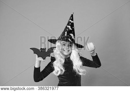 On Halloween Night Youre Sure To Have Fright. Halloween Girl In Witch Hat Orange Background. Little