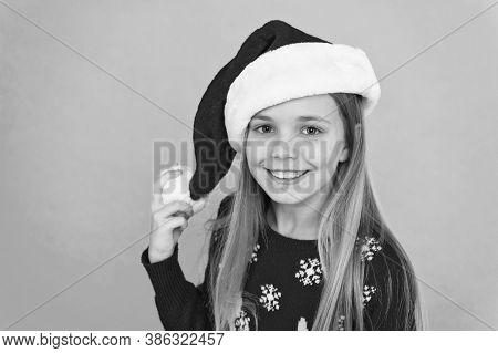Santa Claus Kid. Little Girl Child In Santa Hat. Happy Winter Holidays. Small Girl. Christmas Shoppi