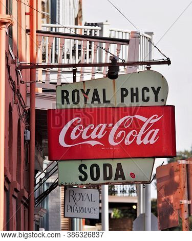 New Orleans, Louisiana/usa - 11/15/2015: Vintage Coca-cola And Royal Pharmacy Sign In French Quarter