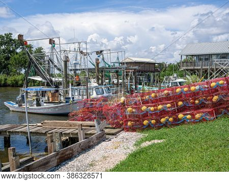 Delacroix, Louisiana/usa - 6/28/2014: Coastal Fishing Boats And Crab Traps On The Bayou In South Lou