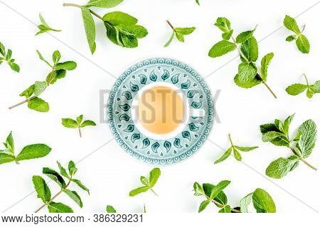 Mint Tea With Frame Made Of Mint Leaves Isolated On White Background. Set Of Peppermint. Mint Patter