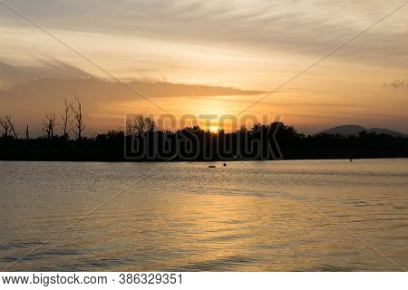 The Sun Went Down Behind The Forest Above The Water Cloudy / Area Bueng Khun Sea /suratthani,thailan