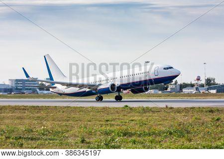 Take Off Passenger Airplane On Airport Runway