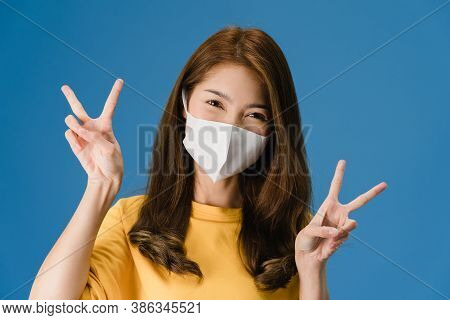 Young Asia Girl Wearing Medical Face Mask Showing Peace Sign, Encourage With Dressed In Casual Cloth