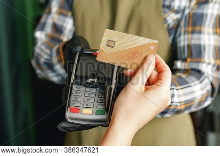 Customer Using Credit Card For Payment At Cafe Or Shop By Terminal With Nfc Cashless Technology