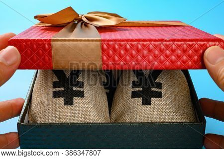 Opening A Gift Box Full With Rmb Money Bags Carefully