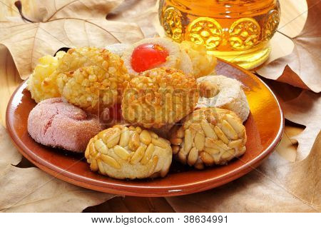panellets, typical pastries of Catalonia, Spain, eaten in All Saints Day, and moscatel, a typical catalan sweet wine poster