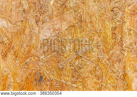 Osb Are Made Of Brown Wood Chips, Ground Into A Wooden Background. Top View Of Osb Wood Veneer, Dens
