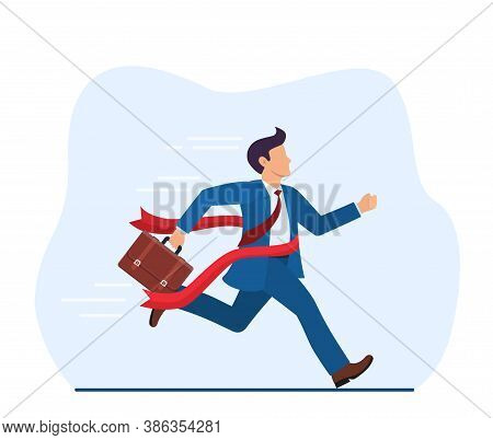 Manager Or Businessman At Finish Line. A Man In A Suit Crosses The Finish Line, Red Ribbon. Business