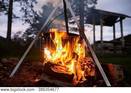 Hiking Pot, Bowler In The Bonfire. Fish Soup Boils In Cauldron At The Stake. Traveling, Tourism, Pic