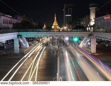 Yangon, Myanmar Feb 21, 2019: Night Time And Speed Of Light Of Golden Octagon Of Sule Pagoda At Squa