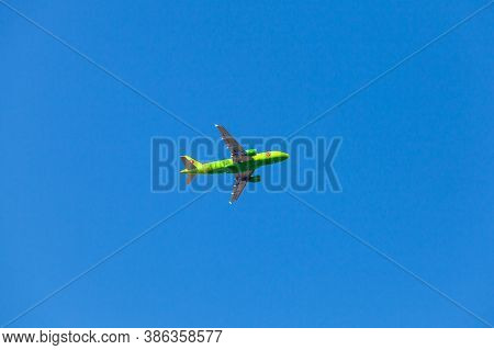 St.petersburg, Russia - April 14, 2019: Airbus A319 Plane Of The S7 Airline Flies In A Blue Sky At D