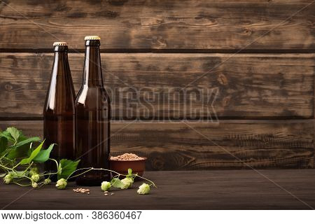 Beer Bottles With Malt And Hops