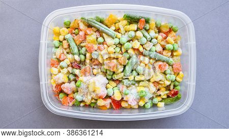 Frozen Mixed Vegetables In A Plastic Container For Long-term Storage. Deep Freezing Of Vegetables. F